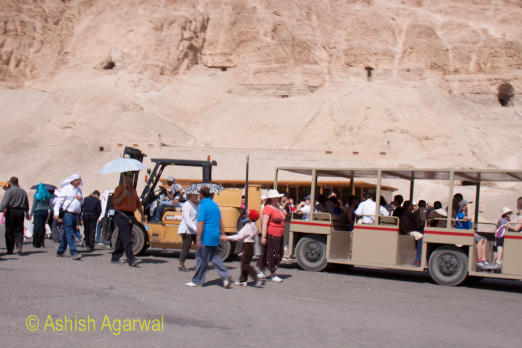 People moving to and fro the electric cars that carried people from tourist buses to the foot of the temple