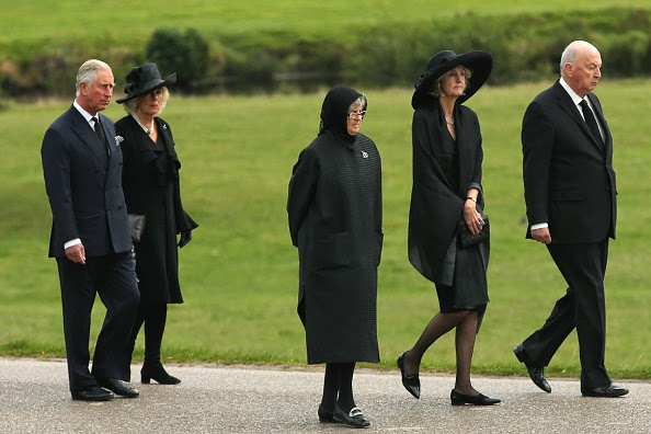 rince Charles, Prince of Wales and Camilla, Duchess of Cornwall follow the Duke of Devonshire (R), Lady Sophia Cavendish and Lady Emma Cavendish (C) as the funeral of Deborah, Dowager Duchess of Devonshire makes it's way to St Peters Church, Edensor, past Chatsworth House on 02.10.2014 in Chatsworth, England.