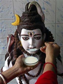 Milk Drinking Statue