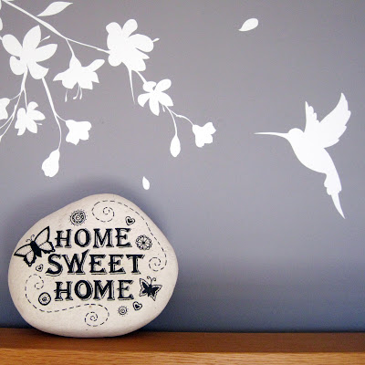 Decorated stone featuring the phrase 'Home sweet home'