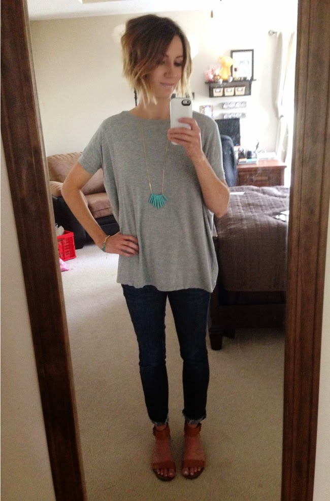 Oversized gray tee, turquoise jewelry, and dark denim
