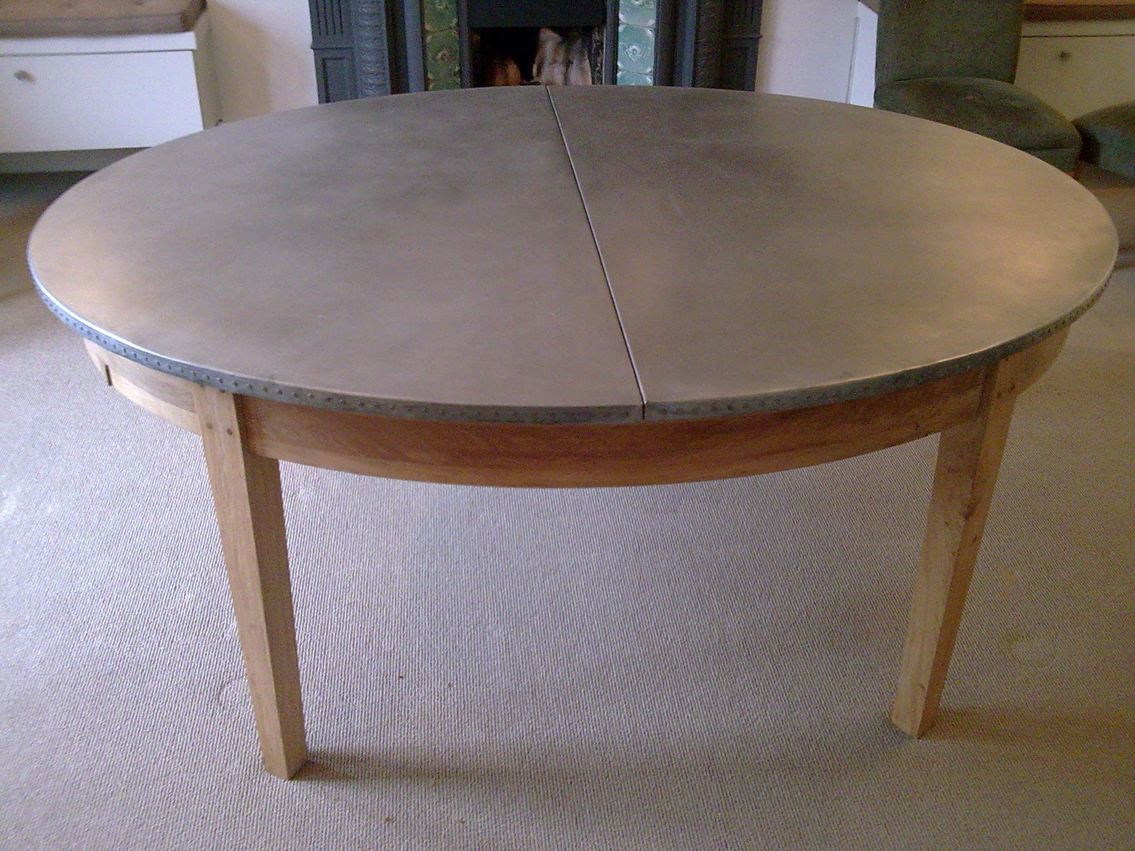 Deballage Designs Oval oak table with a studded zinc top