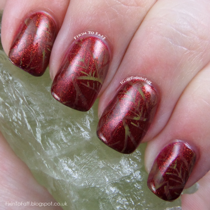 Fall or Autumn leaves nail art with marbled stamping over a glittery base.