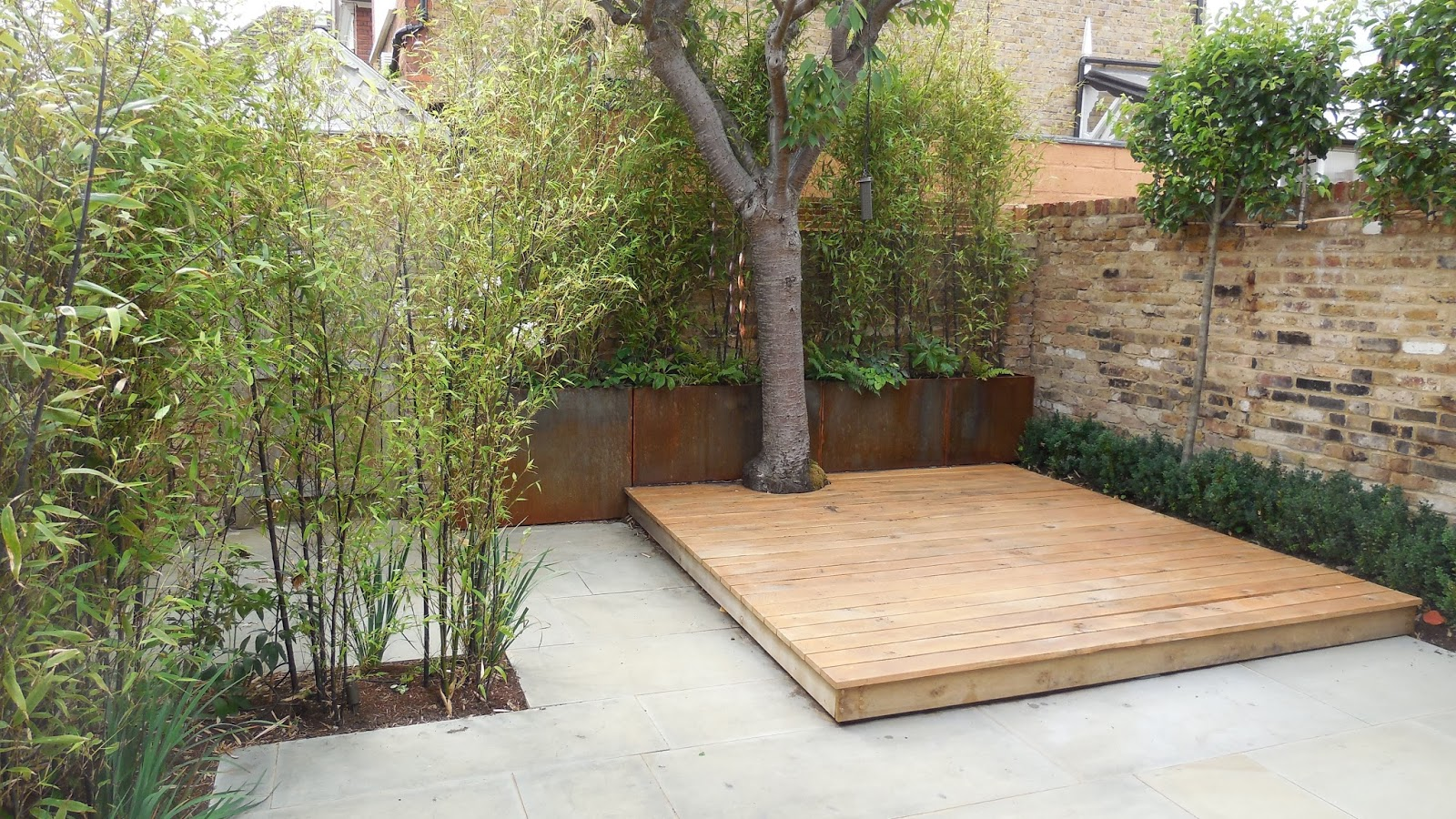 garden planters in london with Industrial Style Courtyard Garden In on Roof Terrace Design Kings Cross St Pancras additionally Rattan Garden Furniture Sofa Set Santa Maria Brown likewise New Front Garden Car Parking Space further Tropical Garden furthermore Battersea.