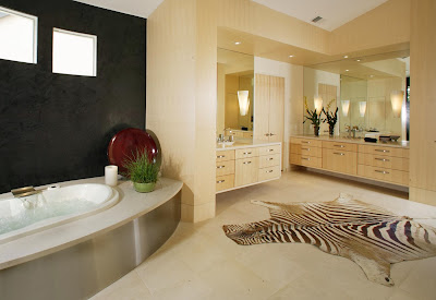 light hues bathroom having cool elegant vanities with large glass mirror wall and cool animal skin rug