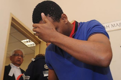Photo: Nigerian student in Malaysia charged for cheating two women on Facebook