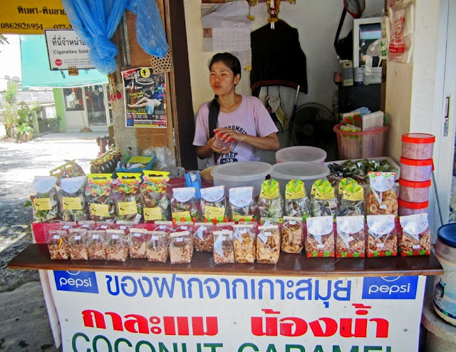 woman vendor selling food on the streets of Koh Samui in Thailand