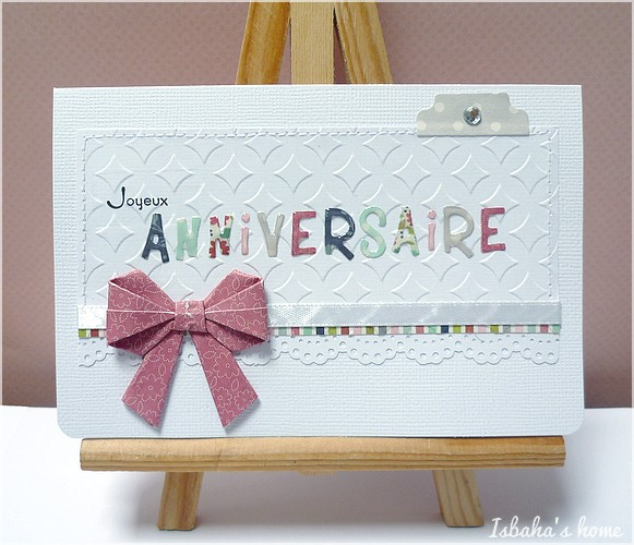 a card with an origami bow