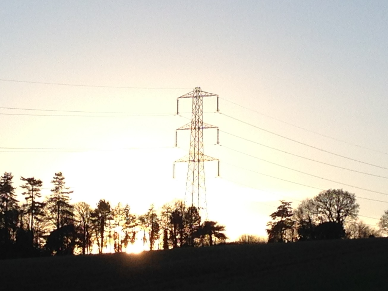 Electricity pylon with the setting sun