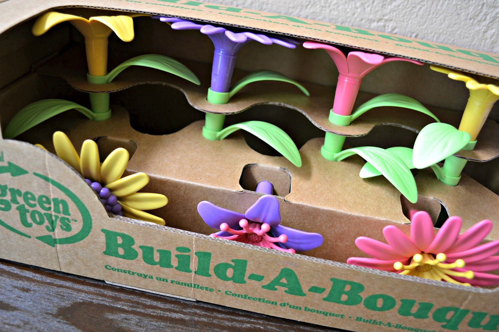 We Re Heading To A Party In Of Weeks For Sweet Little 3 Year Old And Ll Be Bringing This Green Toys Build Bouquet Fl Arrangement