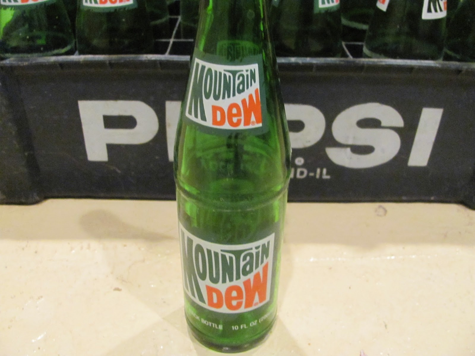 Closeup shot of a single Mountain Dew bottle to show the old logo