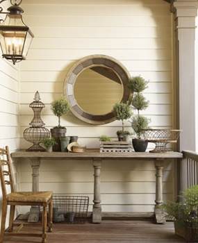 Rustic wooden textures and an accent mirror are gorgeous front porch decorations