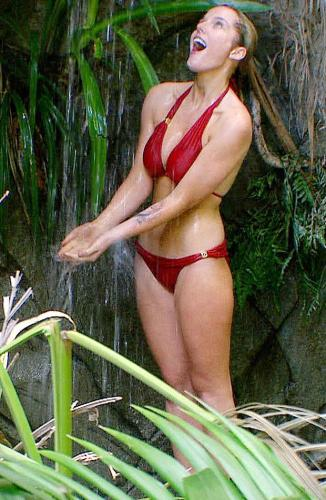 "Helen Flanagan washes her ""Red Bikini"" curves"