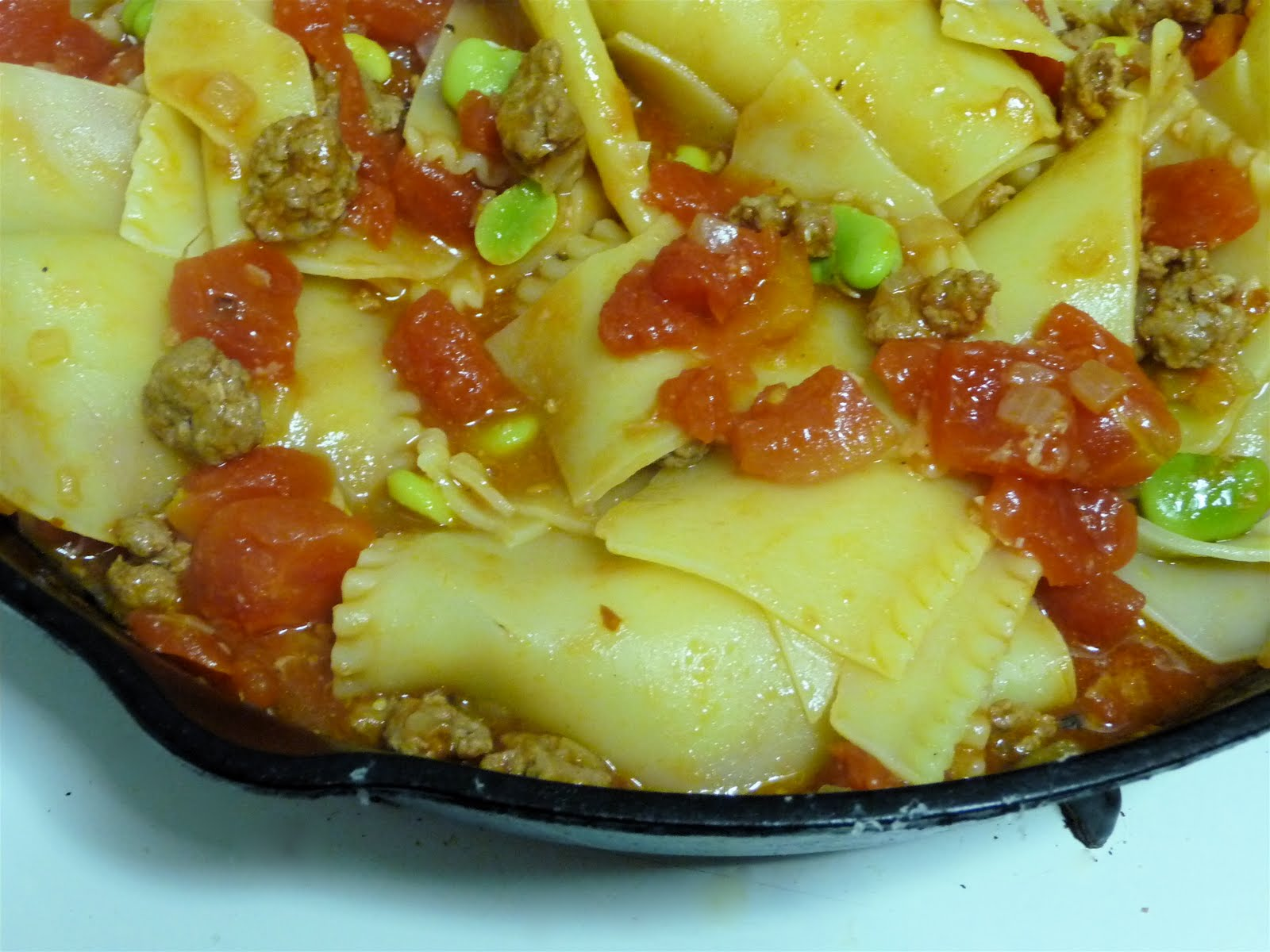 Pasta with tomatoes, fava beans, and lamb sausage