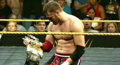 Sami Zayn with NXT Championship belt
