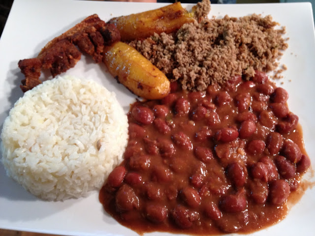 Image of rice, beans, plantains, ground sirloin and pork belly