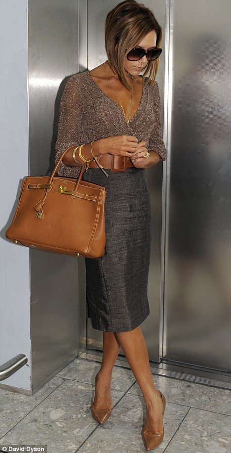 her Hermes Birkin bag among other bags