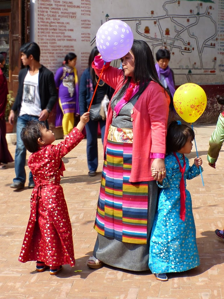Mother and kids wearing traditional Tibetan/Sherpa dress