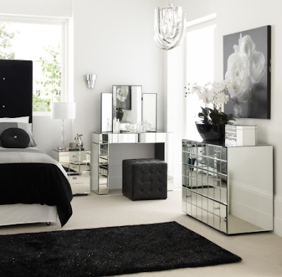 reflective silver furniture with black and white bedding and decor