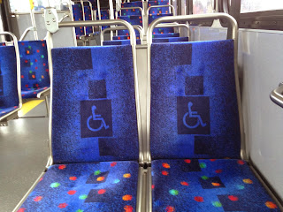 Bus seats with the wheelchair symbol in the upholstery