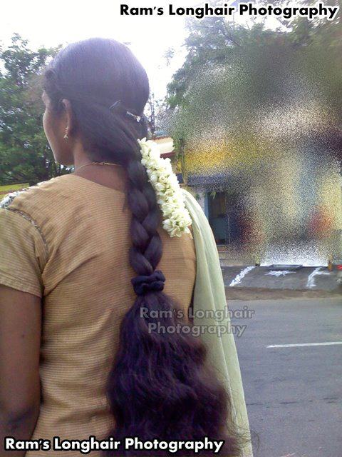 Tamil Nadu college girl with long hair braid.