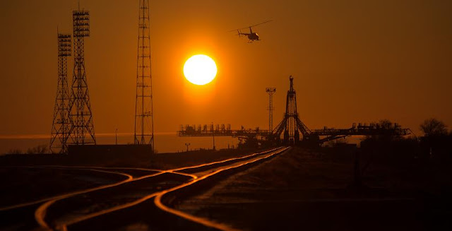 A security helicopter is seen surveying the launch pad area ahead of the Soyuz TMA-16M spacecraft arrival by train, March 25, 2015, Baikonur Cosmodrome, Kazakhstan. Credit: NASA/Bill Ingalls