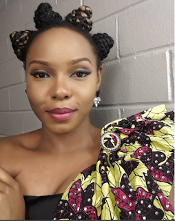 Yemi Alade looks stunning in Zizi Cardow African inspired dress at AFRIMMA Awards.