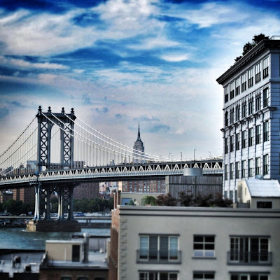 View of the Manhattan bridge and Empire State Building from the Brooklyn Bridge