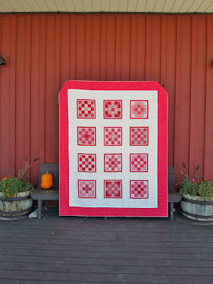 full view of an all red patchwork quilt