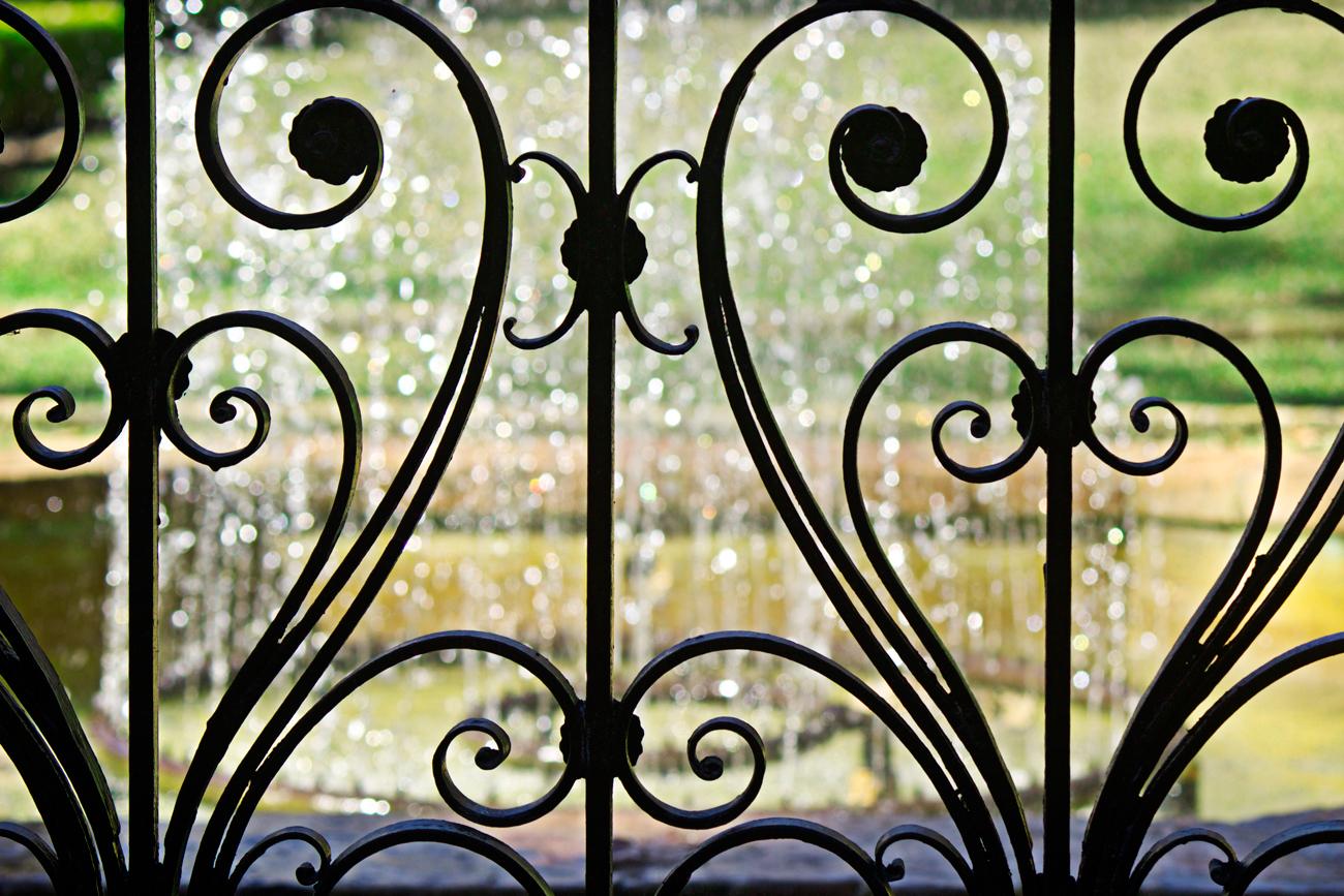iron art nouveau gate with bokeh - photo copyright Allison Beth Cooling