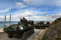 Stryker armored personnel carriers (Credit: AP Photo/Steven Governo) Click to Enlarge.