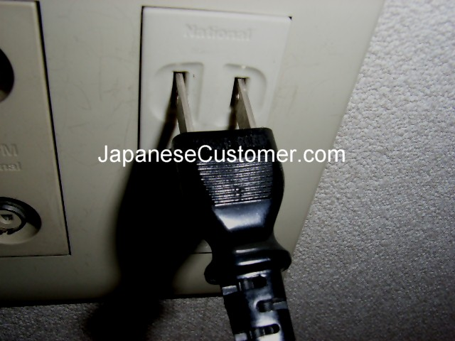 Japanese electricity plug & outlet Copyright peter hanami 2005