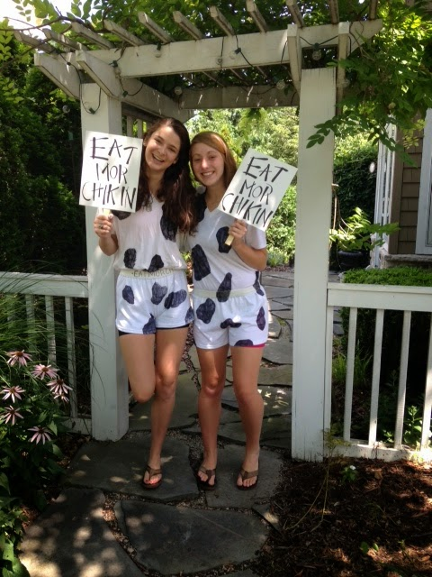 Girls dressed like cows for Chick-Fil-A contest