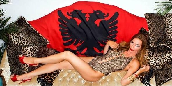 Drita D'avazo poses with Albanian flag