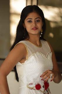Meghasri looks beautiful in white frock