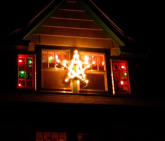 getting the outside decorations squared away dont get too excited about this but look i put extra lights up in our front dormer window in addition