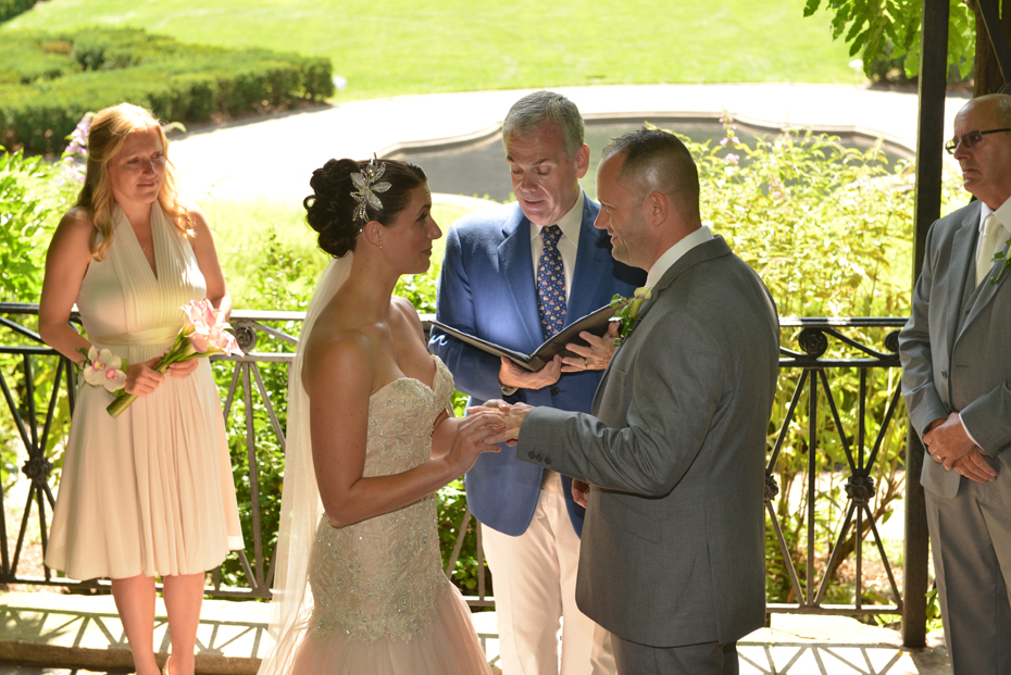 Bride puts ring on the groom's finger - Central Park Wedding
