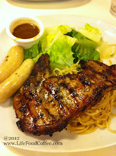 pork chop with sausage from hot tomato restaurant