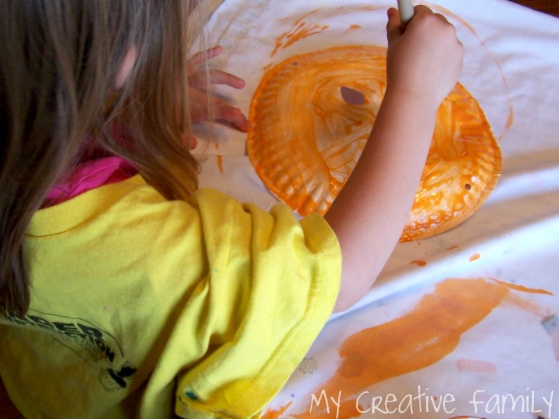 The first step was painting and we painted the entire plate orange.While the plates were drying we pulled out the book about tigers we had found at the ... & Tiger Masks - Creative Family Fun