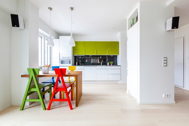 Photo of the kitchen and dining table with colorful chairs