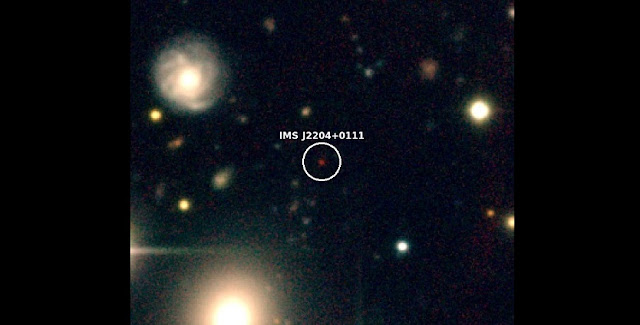 "Color composite-image of IMS J2204+0111 at z=6 (about 1 billion years after the Big Bang). IMS J2204+0111 is the red object at the center and its distance from us is 12.8 billion light years. Because of the expansion of the universe, distant objects like IMS J2204+0111 move away from us almost at the speed of the light, making their light to shift into near-infrared wavelength (phenomenon, called ""redshift""). This makes them look very red in comparison to other objects, and this special color feature enabled the team to identify distant quasar candidates. Credit: gemini.edu"