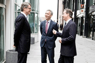 Øyvind Eriksen, executive chairman of Aker Solutions, Norwegian Prime Minister Jens Stoltenberg and David Cameron discussing the deal in a side street in Oslo, Norway.