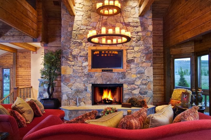 Interiornity  source of interior design ideas   inspirational   viewing the main living room area having comfy sofas centered to the stone  exposed fireplace and. Cabin Style Living Room. Home Design Ideas