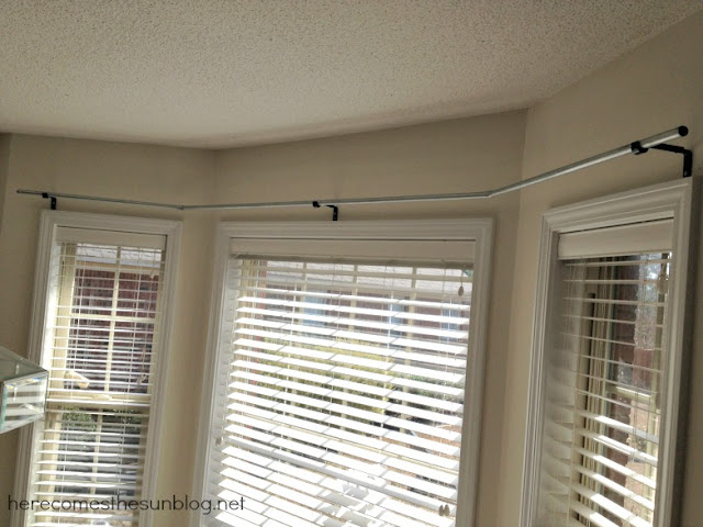 Easy DIY Bay Curtain Rod from herecomesthesunblog.net