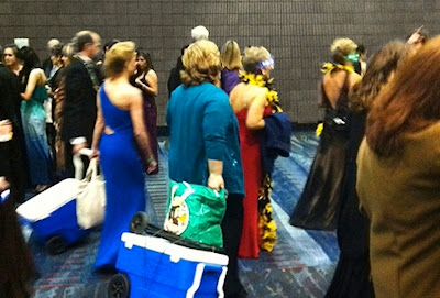 guests drag coolers into Bacchus Mardi Gras Ball