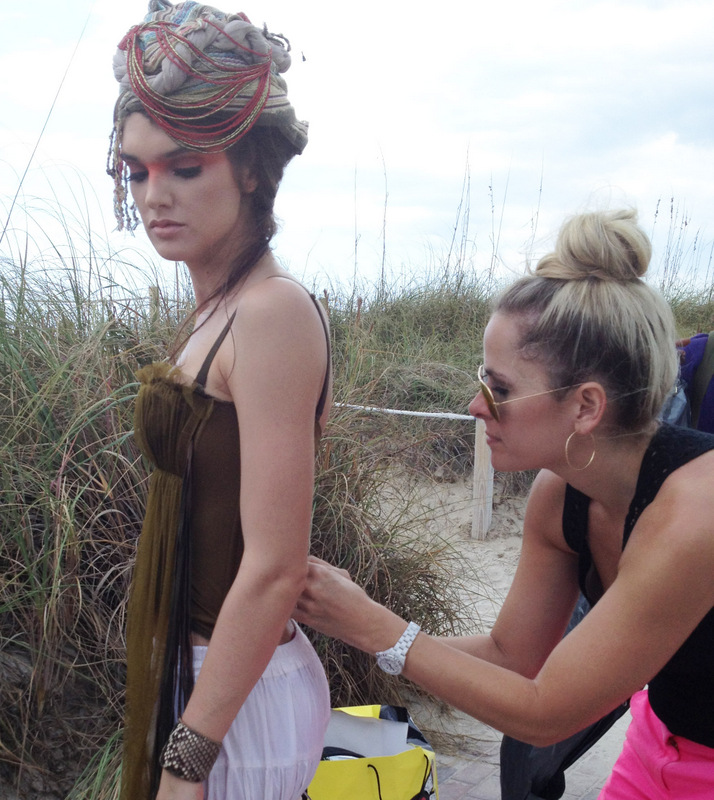 designer and stylist jessica rae anderson styling a model on a shoot
