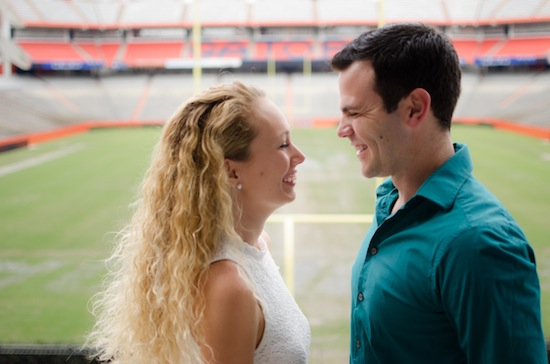 sweet couple laughing together during their engagement session
