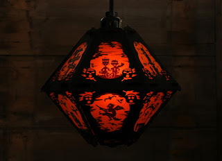 Another view of a paper Halloween lantern in the dark by Bindlegrim