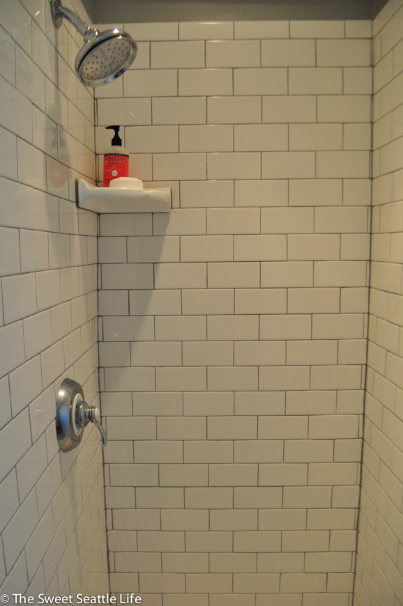 Cute However the contrasting grout accentuates the uneven tiling in the shower and our non square corners whereas a white grout would have blended the tiles