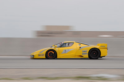 Yellow Ferrari FXX Racing on Track